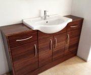 Sink in wood cabinet